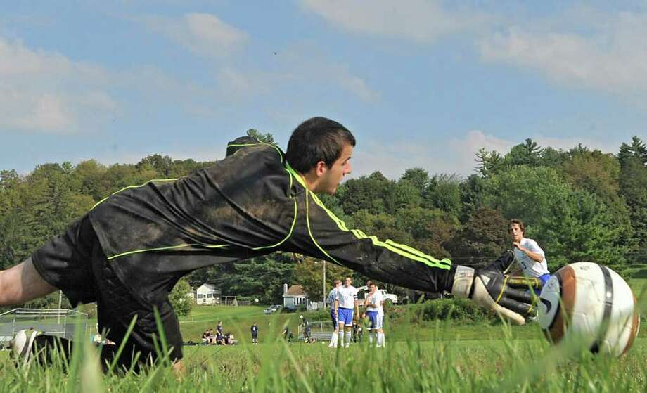 Schoharie goalie Shawn Hoose,17, dives for the ball during warm ups before a soccer game at Schoharie High School in Schoharie, N.Y. on Sept. 14, 2011. (Lori Van Buren / Times Union) Photo: Lori Van Buren