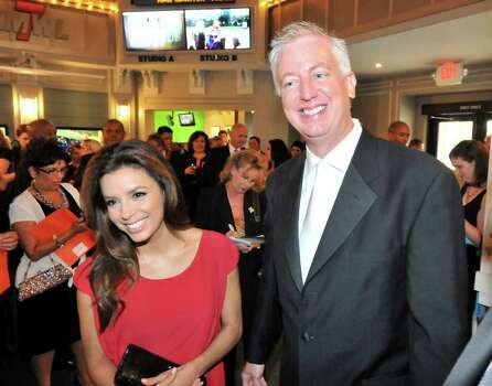 Actress Eva Longoria  and founder of Morgan's Wonderland, Gordon Hartman, talk with guests at a reception prior to a gala fundraiser at the park Saturday evening. Photo: Robin Jerstad/Special To The Express-News