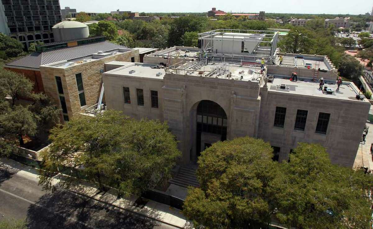 This view of The Briscoe Western Art Museum on Market street shows the old Hertzberg Circus Museum (grey building on right) and the new addition on the left with limestone and copper walls.