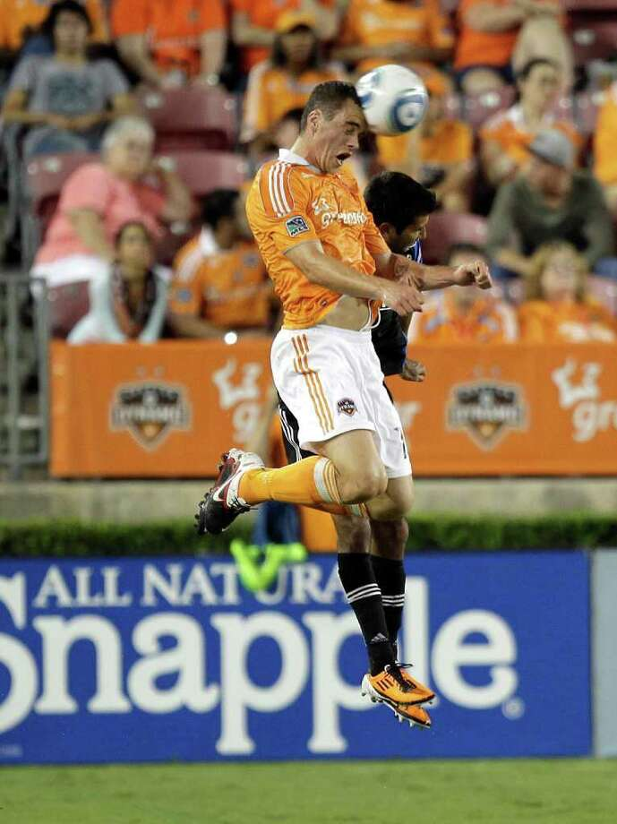 Cam Weaver #15 of the Houston Dynamo heads the ball away from Steven Beitashour #33 of the San Jose Earthquakes at Robertson Stadium on September 17, 2011 in Houston, Texas. Photo: Bob Levey, Getty / 2011 Getty Images
