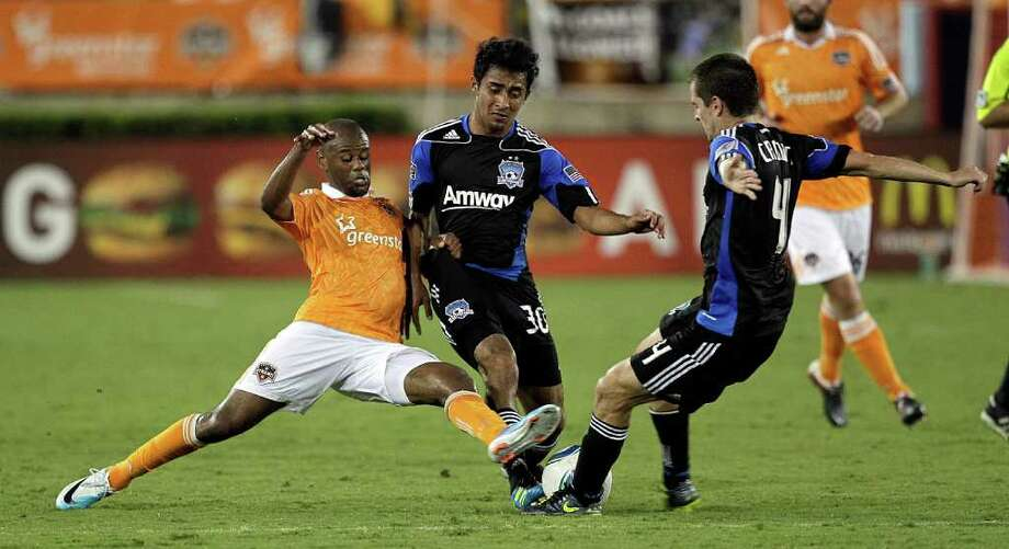 Luiz Camargo #17 of the Houston Dynamo battles for the ball with Rafael Baca #30 and Sam Cronin #4 of the San Jose Earthquakes at Robertson Stadium on September 17, 2011 in Houston, Texas. Photo: Bob Levey, Getty / 2011 Getty Images