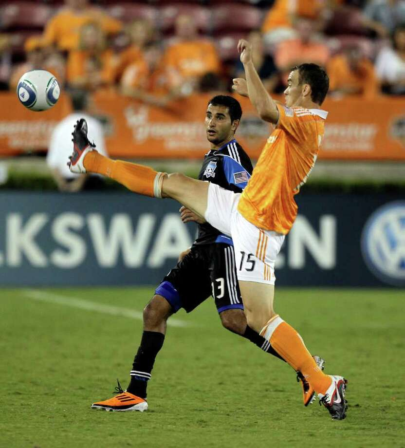 Cam Weaver #15 of the Houston Dynamo attempts to gain control of the ball as Steven Beitashour #33 of the San Jose Earthquakes jockies for position at Robertson Stadium on September 17, 2011 in Houston, Texas. Photo: Bob Levey, Getty / 2011 Getty Images