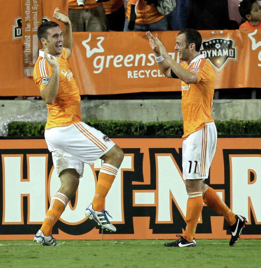 Will Bruin #12, left, of the Houston Dynamo, does his dancing bear routine with Brad Davis #11 after scoring in the 79th minute against the San Jose Earthquakes at Robertson Stadium on September 17, 2011 in Houston, Texas. Houston won 2-1. Photo: Bob Levey, Getty / 2011 Getty Images