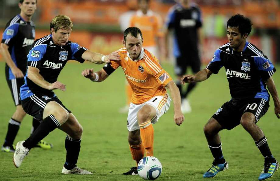 HOUSTON - SEPTEMBER 17:  Brad Davis #11 of the Houston Dynamo looks for room between Jacob Peterson #19 and Rafael Baca #30 of the San Jose Earthquaes at Robertson Stadium on September 17, 2011 in Houston, Texas. Houston won 2-1. Photo: Bob Levey, Getty / 2011 Getty Images