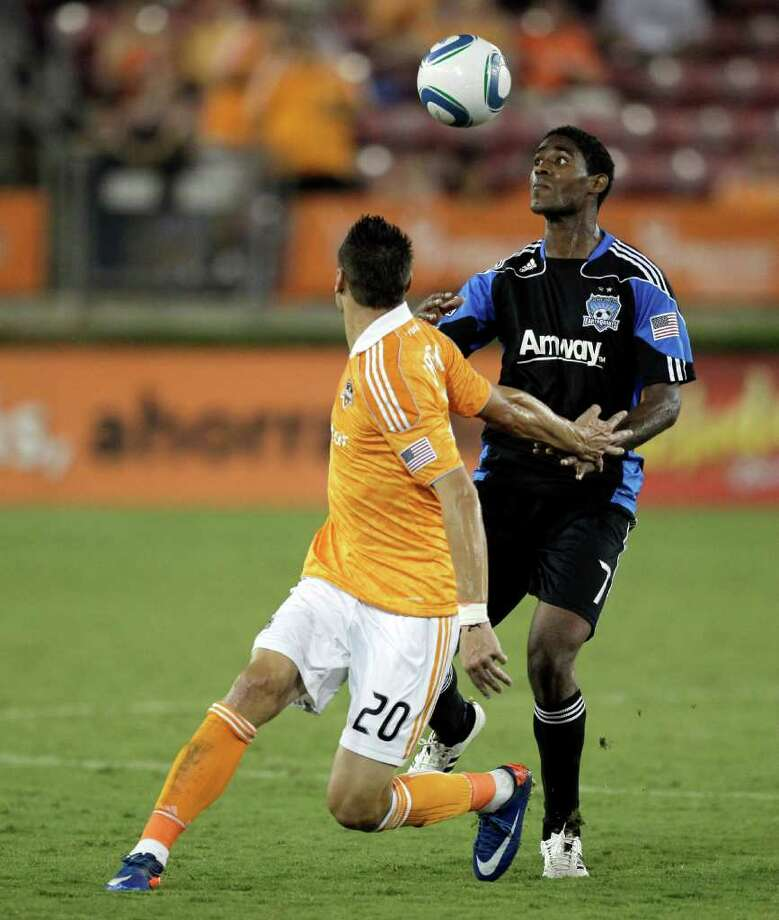 Khari Stephenson #7 of the San Jose Earthquakes and Geoff Cameron #20 of the Houston Dynamo battle for possession for the ball in the second half at Robertson Stadium on September 17, 2011 in Houston, Texas.  Houston wo 2-1. Photo: Bob Levey, Getty / 2011 Getty Images