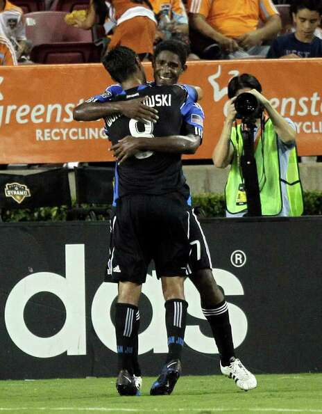 HOUSTON - SEPTEMBER 17:  Khari Stevenson #7 of the San Jose Earthquakes is congratulated by Chris Wo