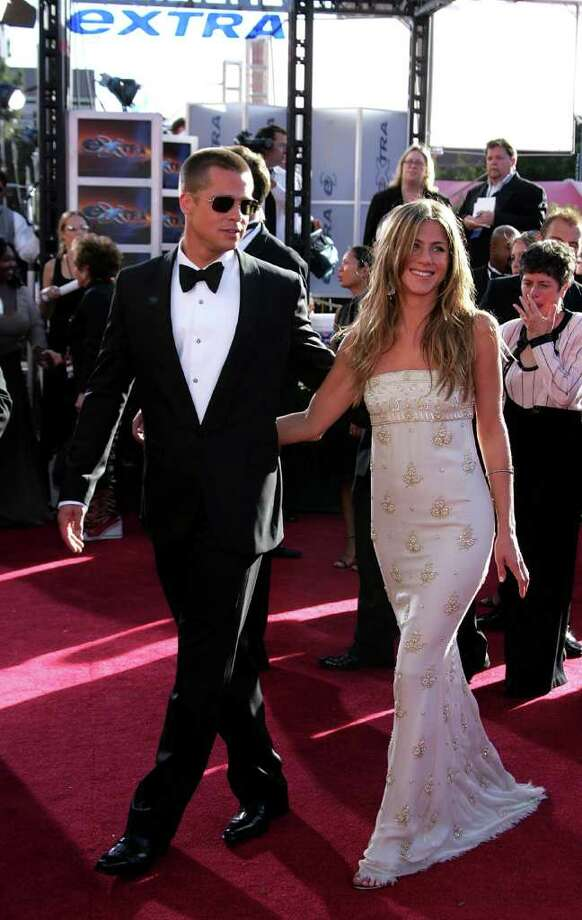 Actors Brad Pitt and Jennifer Aniston attend the 56th Annual Primetime Emmy Awards at the Shrine Auditorium September 19, 2004 in Los Angeles, California. A few months later, the couple announced their separation. Aniston filed for divorce on March 25, 2005.  Photo: Carlo Allegri, Getty Images / 2004 Getty Images