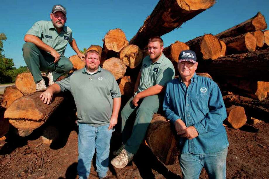 Three generations of Rogers lumbermen, from left, Vince, 47, and his two sons Jeff, 29, Cory, 21, and their grandfather Jerry, 69, continue to cut pine much like they did over 40 years ago at their  five acre sawmill in Orange.  September, 14, 2011 Valentino Mauricio/The Enterprise Photo: Valentino Mauricio