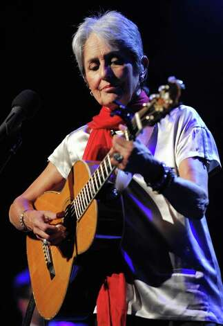 Arts & Entertainment: 4. Joan Baez, born to a Mexican father and a Scottish mother, was the first Hispanic American entertainer to appear on Time magazine's cover. Photo: FABRICE COFFRINI, Getty Images / 2008 AFP
