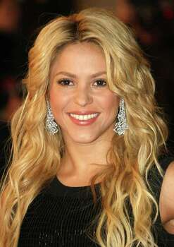 Arts & Entertainment: 3. Latino performer known by a single name: Colombian pop star Shakira. Photo: LIONEL CIRONNEAU, Associated Press / AP