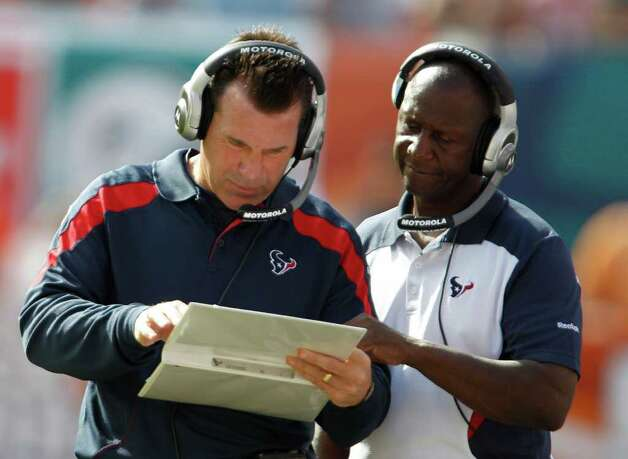 Houston Texans head coach Gary Kubiak looks at plays during the first half of an NFL football game against the Miami Dophins,  Sunday, Sept. 18, 2011, in Miami. (AP Photo/Lynn Sladky) Photo: Lynn Sladky, Associated Press / AP