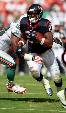 Houston Texans running back Arian Foster (23) runs as Miami Dolphins inside linebacker Karlos Dansby (58) attempts to tackle, during the first half of an NFL football game Sunday, Sept. 18, 2011, in Miami. (AP Photo/Wilfredo Lee) Photo: Wilfredo Lee, Associated Press / AP