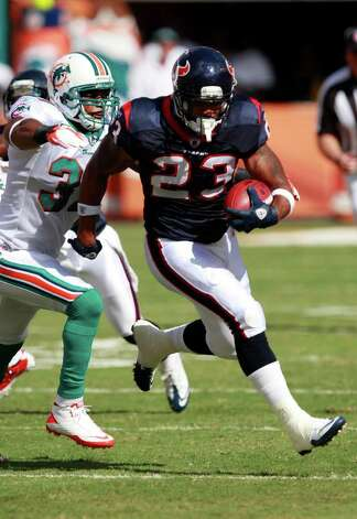 Houston Texans running back Arian Foster (23) runs as Miami Dolphins strong safety Yeremiah Bell (37) attempts to tackle during the first half of an NFL football game Sunday, Sept. 18, 2011, in Miami. (AP Photo/Wilfredo Lee) Photo: Wilfredo Lee, Associated Press / AP