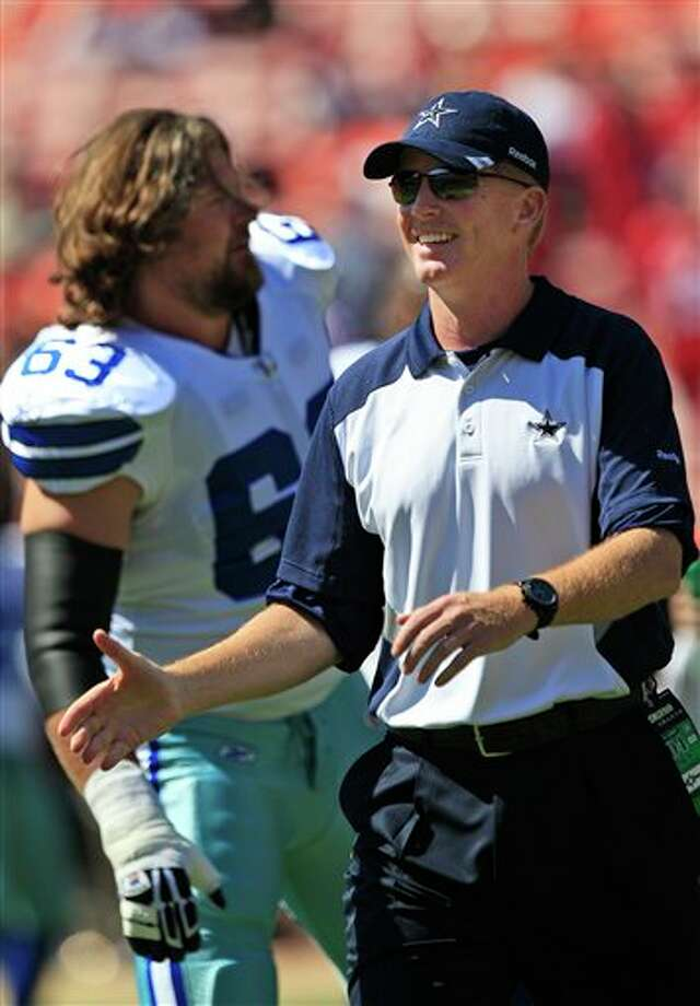 Dallas Cowboys head coach Jason Garrett, right, is shown next to guard Kyle Kosier (63) before quarter of an NFL football game against the San Francisco 49ers in San Francisco, Sunday, Sept. 18, 2011. (AP Photo/Marcio Jose Sanchez) Photo: Associated Press