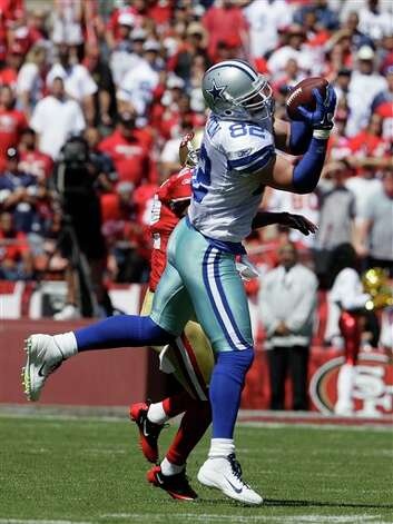 Dallas Cowboys tight end Jason Witten (82) catches a pass in front of San Francisco 49ers cornerback Carlos Rogers (22) in the first quarter of an NFL football game in San Francisco, Sunday, Sept. 18, 2011. (AP Photo/Jeff Chiu) Photo: Associated Press