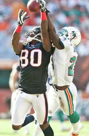 Houston Texans wide receiver Andre Johnson (80) as Miami Dolphins cornerback Vontae Davis (21) tries to cover in the second quarter of a NFL football game, Sunday, Sept. 18, 2011, in Sun Life Stadium in Miami. Photo: Nick De La Torre, Houston Chronicle / © 2011 Houston Chronicle