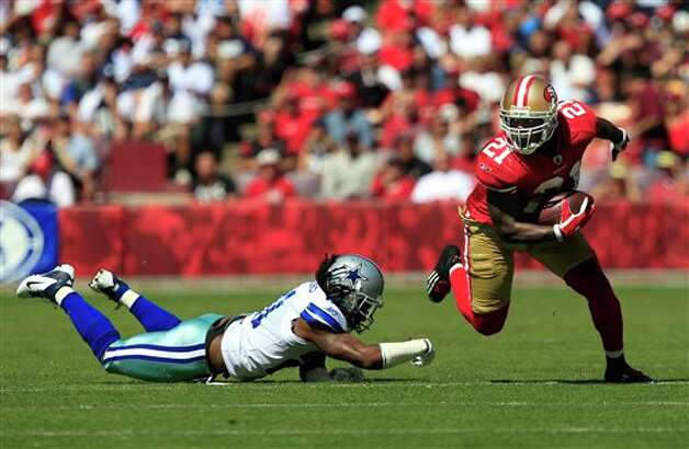 San Francisco 49ers running back Frank Gore (21) runs away from Dallas Cowboys defensive back Mike Jenkins (21) in the second quarter of an NFL football game in San Francisco, Sunday, Sept. 18, 2011. (AP Photo/Marcio Jose Sanchez) Photo: Associated Press