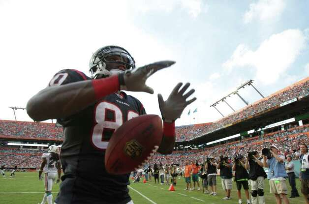 Houston Texans wide receiver Andre Johnson (80) points to he crowd after scoring a touch down in the fourth quarter of a NFL football game against the Miami Dolphins, Sunday, Sept. 18, 2011, in Sun Life Stadium in Miami. The Texans won 23-13. Photo: Nick De La Torre, Houston Chronicle / © 2011 Houston Chronicle