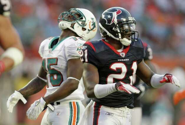 Houston Texans defensive back Brice McCain (21) makes an incomplete signal after breaking up a pass for Miami Dolphins wide receiver Davone Bess (15) late in the fourth quarter of a NFL football game, Sunday, Sept. 18, 2011, in Sun Life Stadium in Miami. The Texans won 23-13. Photo: Nick De La Torre, Houston Chronicle / © 2011 Houston Chronicle