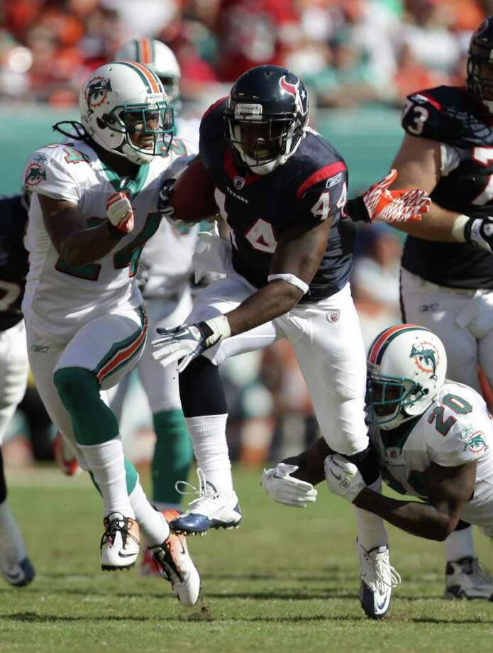 Houston Texans running back Ben Tate (44) tries to make Miami Dolphins free safety Reshad Jones (20) miss as he tries to run into the Miami Dolphins secondary in the third quarter of a NFL football game, Sunday, Sept. 18, 2011, in Sun Life Stadium in Miami. The Texans won 23-13. Photo: Nick De La Torre, Houston Chronicle / © 2011 Houston Chronicle
