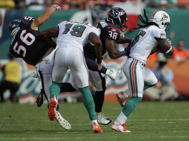 Houston Texans inside linebacker Brian Cushing (56) gets blocked as he and Houston Texans free safety Danieal Manning (38) try to tackle Miami Dolphins wide receiver Davone Bess (15) in the third quarter of a NFL football game, Sunday, Sept. 18, 2011, in Sun Life Stadium in Miami. The Texans won 23-13. Photo: Nick De La Torre, Houston Chronicle / © 2011 Houston Chronicle