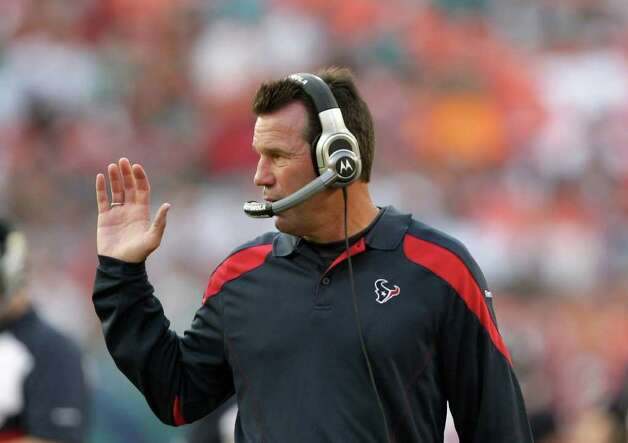Houston Texans head coach Gary Kubiak talks to assistant coaches as his offense pounds the rock in the fourth quarter of a NFL football game against the Miami Dolphins, Sunday, Sept. 18, 2011, in Sun Life Stadium in Miami. The Texans won 23-13. Photo: Nick De La Torre, Houston Chronicle / © 2011 Houston Chronicle