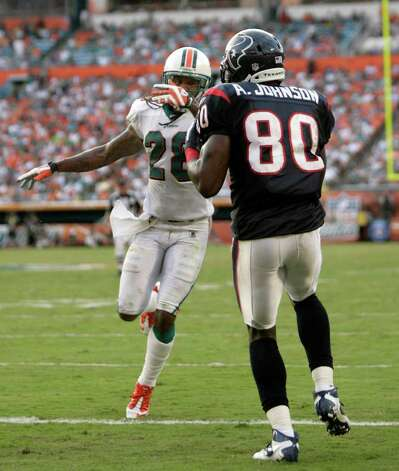 Houston Texans wide receiver Andre Johnson (80) makes a touchdown catch as he gets behind Miami Dolphins defensive back Nolan Carroll (28) in the fourth quarter of a NFL football game, Sunday, Sept. 18, 2011, in Sun Life Stadium in Miami. The Texans won 23-13. Photo: Nick De La Torre, Houston Chronicle / © 2011 Houston Chronicle