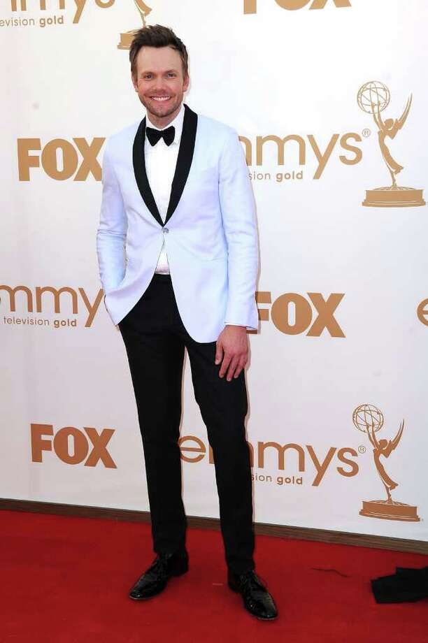 "Worst: What was ""The Soup"" host Joel McHale thinking with this baby blue tux jacket? Thankfully, he quickly changed for his role in the Emmy's singing quintet.  Photo: Frazer Harrison, Getty Images / 2011 Getty Images"