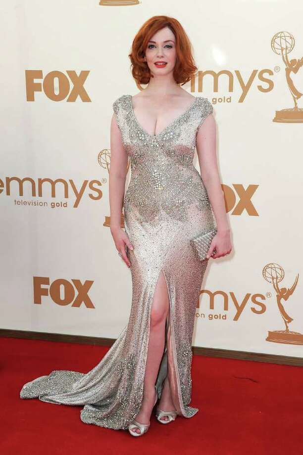 Best: Christina Hendricks was characteristically va-va-voom on the red carpet in a low cut, shimmering dress.  Photo: Frazer Harrison, Getty Images / 2011 Getty Images