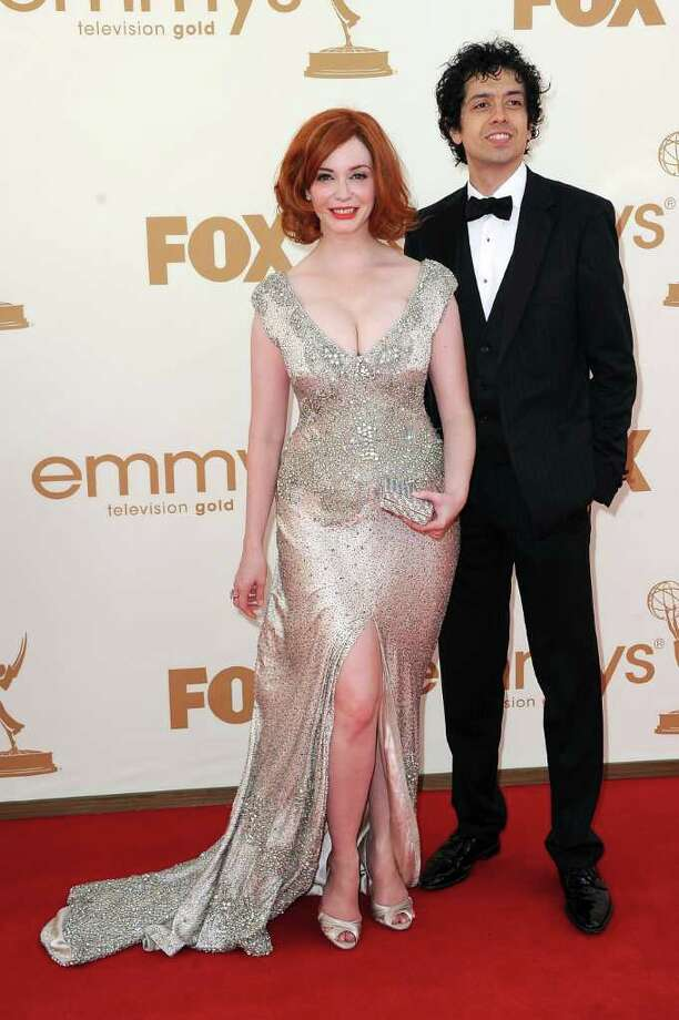 LOS ANGELES, CA - SEPTEMBER 18:  Actress Christina Hendricks (L) and actor  Geoffrey Arend arrive at the 63rd Annual Primetime Emmy Awards held at Nokia Theatre L.A. LIVE on September 18, 2011 in Los Angeles, California. Photo: Frazer Harrison, Getty Images / 2011 Getty Images