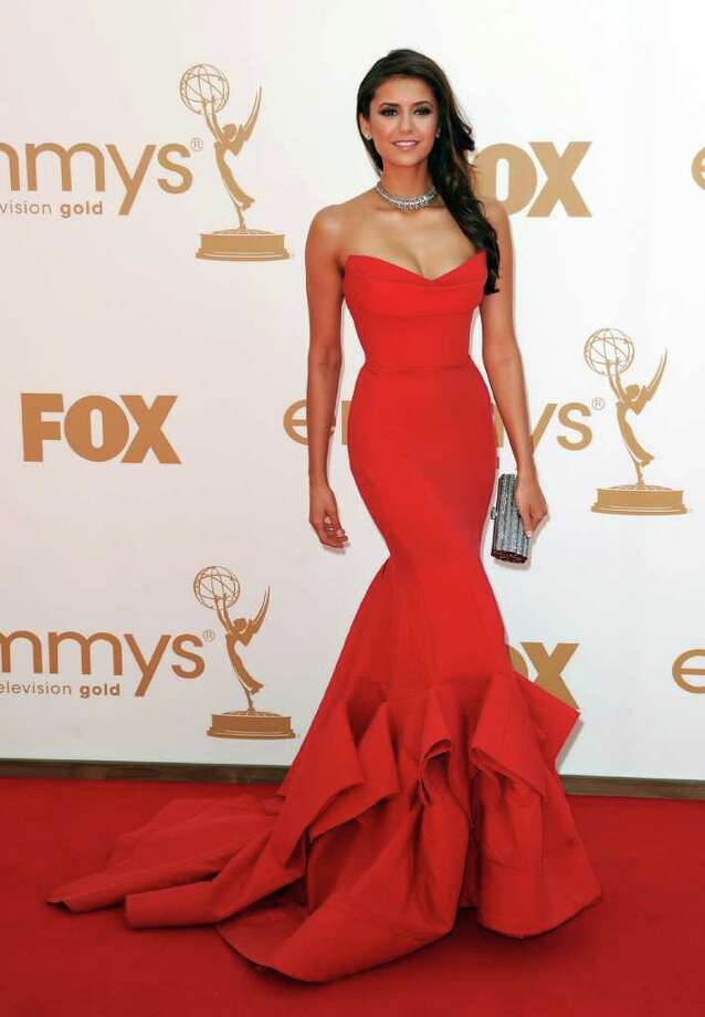 "Best: Nina Dobrev also stunned in red. The form-fitting Donna Karan number perfectly suited the ""Vampire Diaries"" star.  Photo: Kevin Winter, Getty Images / 2011 Getty Images"