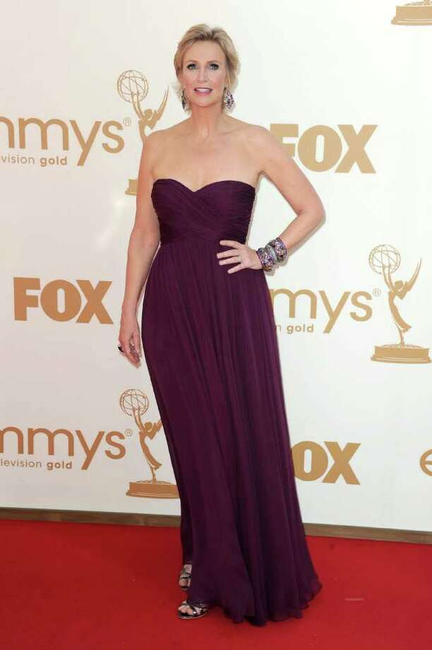 Best: For her first of many ensembles throughout the evening, Jane Lynch looked elegant in deep plum.  Photo: Kevin Winter, Getty Images / 2011 Getty Images