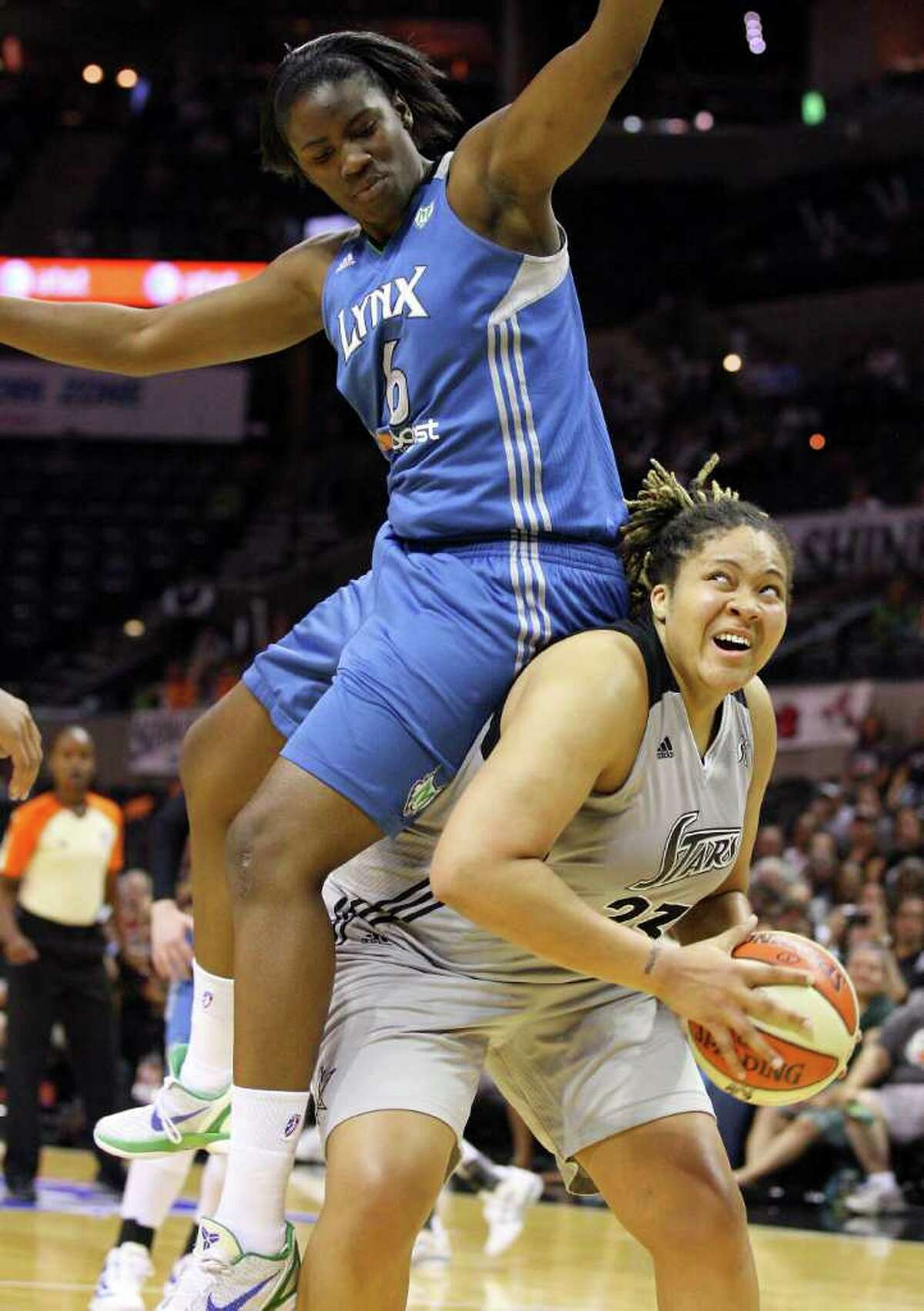 Silver Stars' Danielle Adams is fouled by Minnesota Lynx's Amber Harris during first half action of Game 2 in the Western Conference semifinal Sunday Sept. 18, 2011 at the AT&T Center.