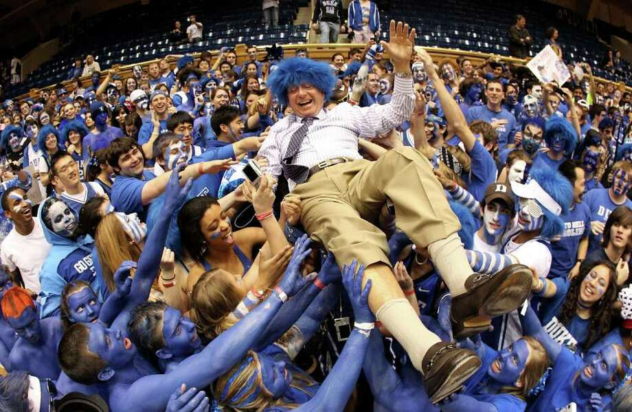 DURHAM, NC - MARCH 06:  ESPN analyst Dick Vitale surfs the crowd with the Cameron Crazies before the start of the game between the North Carolina Tar Heels and Duke Blue Devils at Cameron Indoor Stadium on March 6, 2010 in Durham, North Carolina.  With the college spots landscape quickly moving, Ben Doody writes it's imperative that UConn push hard for a spot alongside the Blue Devils and Tar Heels in the ACC. (Photo by Streeter Lecka/Getty Images) Photo: Streeter Lecka, ST / 2010 Getty Images