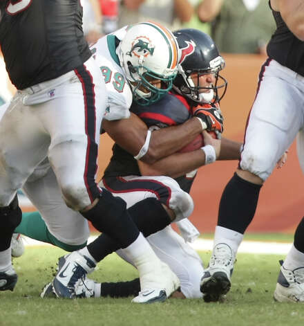 Miami Dolphins linebacker Jason Taylor (99) sacks Houston Texans quarterback Matt Schaub (8) in the third quarter quarter of a NFL football game, Sunday, Sept. 18, 2011, in Sun Life Stadium in Miami. The Texans won 23-13. Photo: Nick De La Torre, Houston Chronicle / © 2011 Houston Chronicle