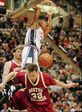 Connecticut's Ray Allen comes down between Boston College's Paul Grant, left, and Marc Molinsky, right, after dunking the ball in the first half of their Big East Conference game in Hartford, Conn., Tuesday, Feb. 21, 1995. Connecticut defeated Boston College 88-75. The New England schools, once rivals in the Big East, could be reunited in the ACC if UConn secures an invitation. (AP Photo/Bob Child) Photo: BOB CHILD, GT / AP2011