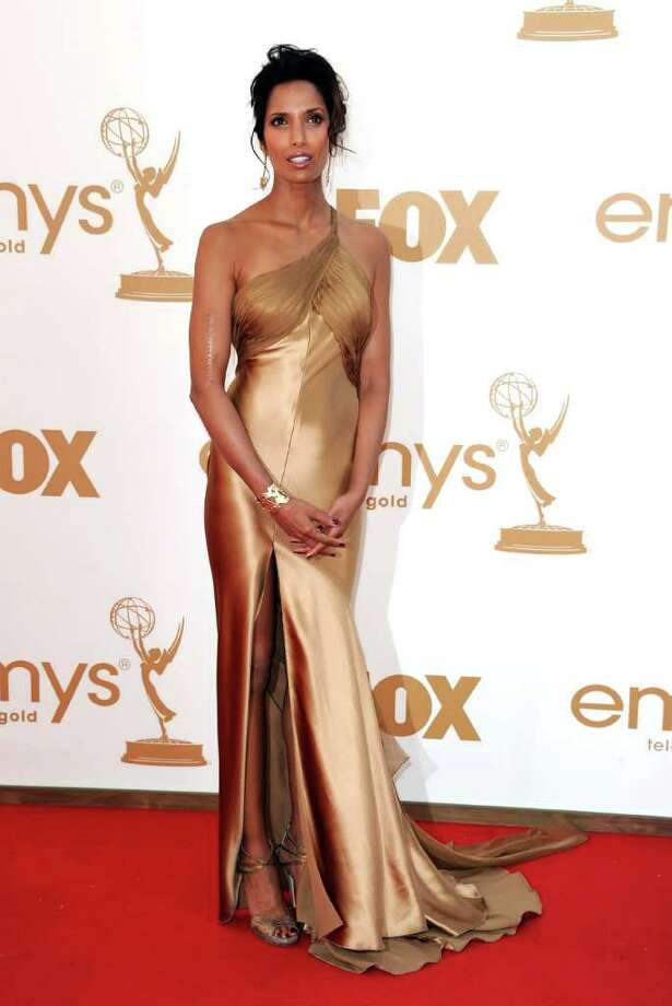 Worst: Padma Lakshmi looked like she rolled out of bed and straight to the red carpet. The ill-fitting bronze gown didn't help her cause.  Photo: Kevin Winter, Getty Images / 2011 Getty Images