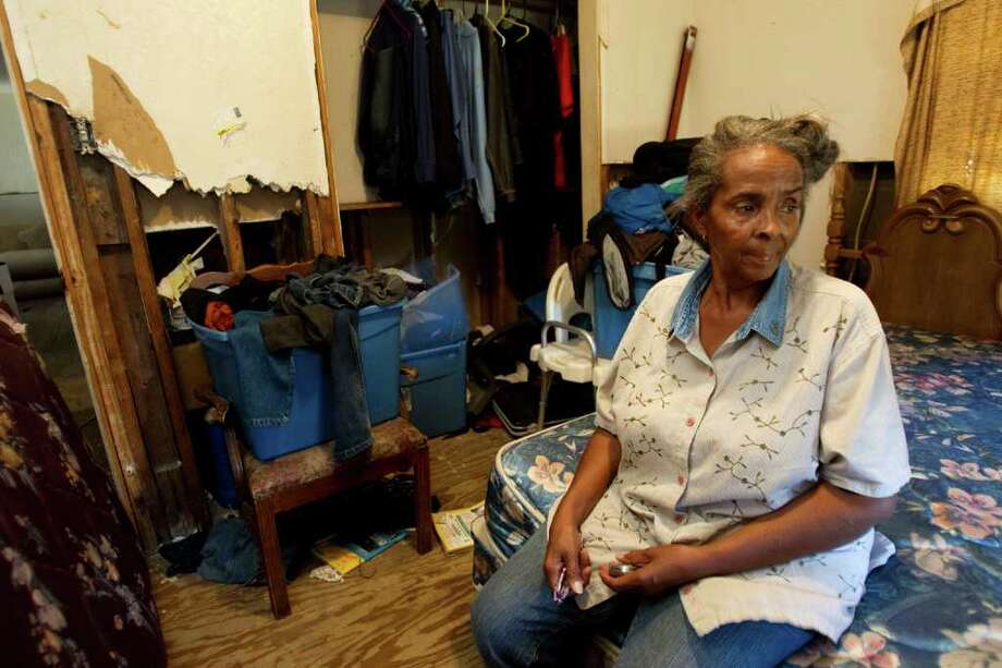 Joyce Hudson - whose Hurricane Ike-damaged home Hitchcock is to be torn down and rebuilt under a federal program - doesn't have the money to move and rent a home while her house is being rebuilt. Photo: Brett Coomer / © 2011 Houston Chronicle