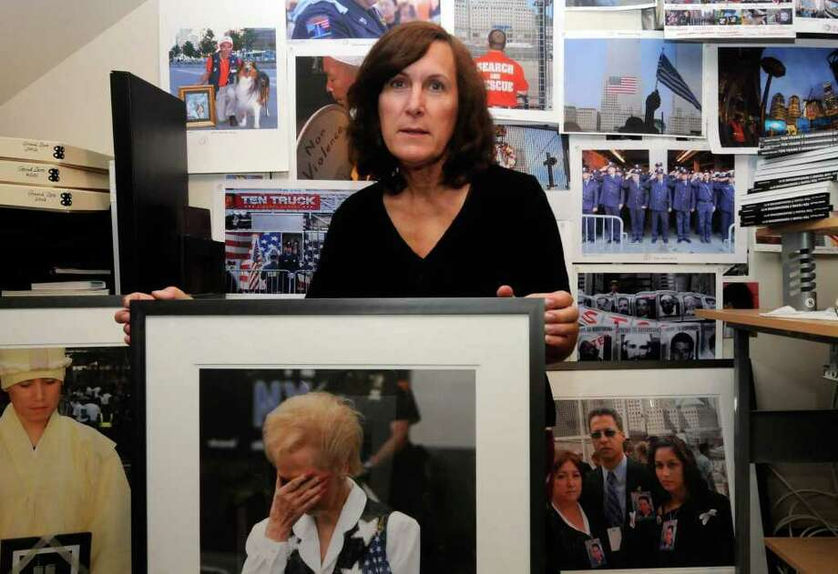 "Local photographer Marie Triller, who has visited the 9/11 memorial at ground zero every anniversary and has just published a photography book, ""Ten Years: Remembering 9/11"" at her home in Albany, NY Thursday Sept.8, 2011. ( Michael P. Farrell/Times Union) Photo: Michael P. Farrell"