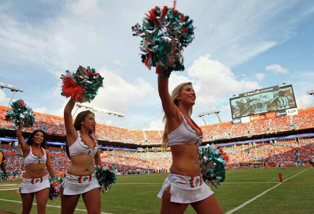 Miami Dolphins Cheerleaders are shown during the second half of an NFL football game between the Miami Dolphins and the Houston Texans, Sunday, Sept.  18, 2011 in Miami. The Texans defeated the Dolphins 23-13. (AP Photo/Wilfredo Lee) Photo: Wilfredo Lee, Associated Press / AP