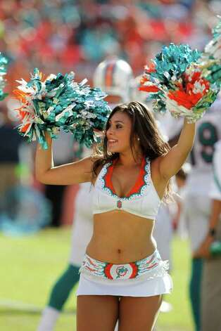 A Miami Dolphins cheerlerader performs during the first half of an NFL football game against the Houston Texans, Sunday, Sept. 18, 2011, in Miami. (AP Photo/Lynne Sladky) Photo: Lynne Sladky, Associated Press / AP