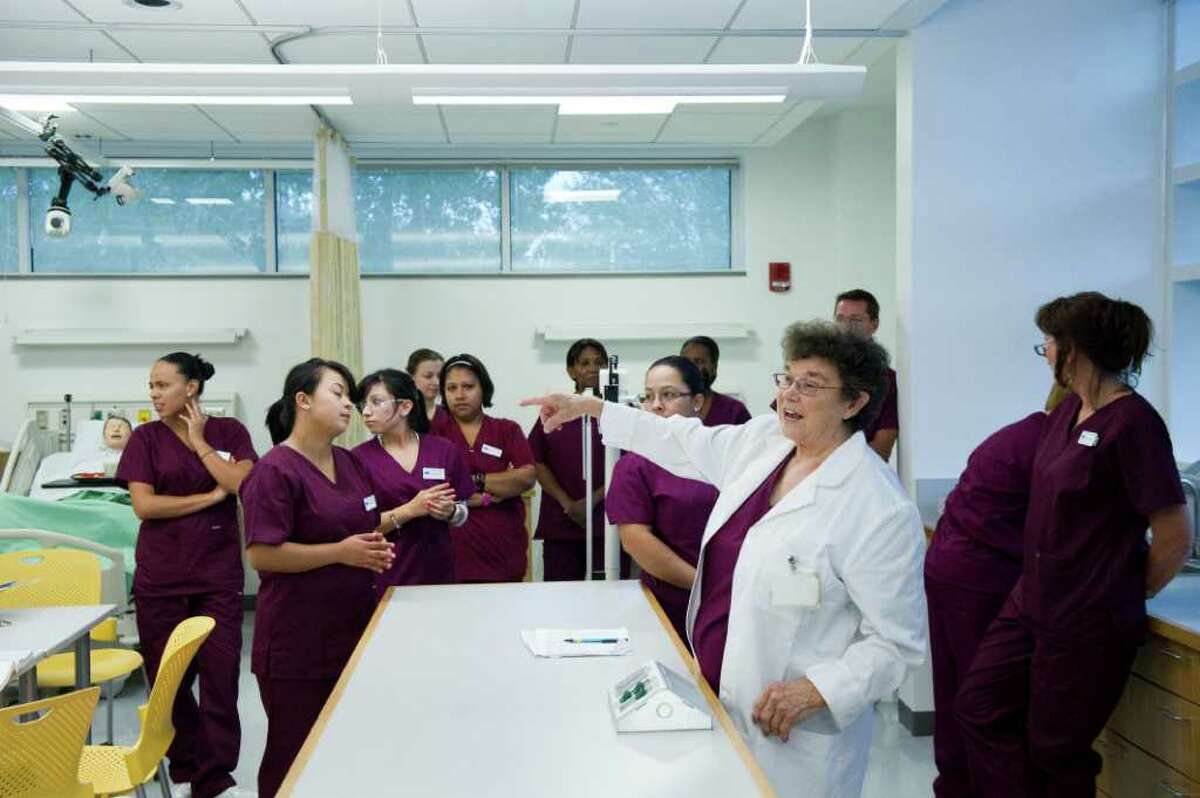 Pat Lesiw, instructor of certified nursing, discusses the perks of her new classroom during a break with students in Norwalk Community College's new Center for Science, Health and Wellness in Norwalk, Conn., September 15, 2011. The educational facility features simulation rooms and simulations mannequins allowing students to have real life experiences while in an academic setting. The center was developed in cooperation with Greenwich, Norwalk and Stamford hospitals which resulted in classrooms modeled after the hospitals.