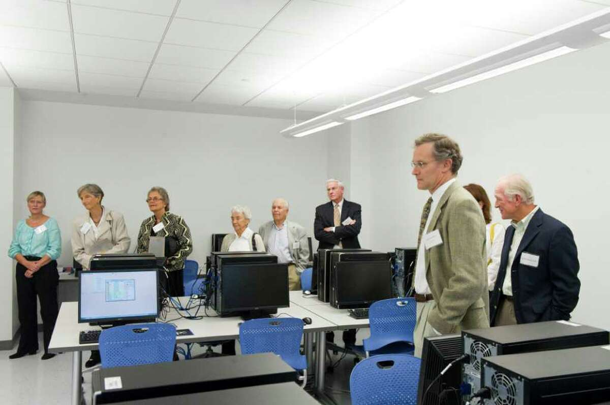 Carl Goodnow, right, leads a tour of the Norwalk Community College's new Center for Science, Health and Wellness in Norwalk, Conn., September 15, 2011. The educational facility features simulation rooms and simulations mannequins allowing students to have real life experiences while in an academic setting. The center was developed in cooperation with Greenwich, Norwalk and Stamford hospitals which resulted in classrooms modeled after the hospitals.