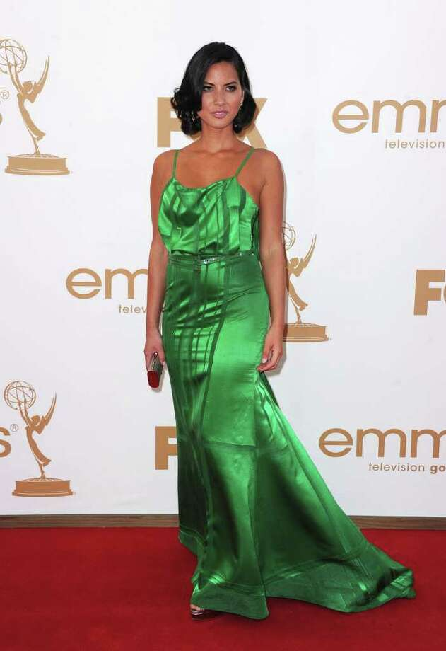 Worst: Olivia Munn certainly stood out in this jungle green confection, but the awkward front draping and shiny fabric  of the gown were less than flattering.  Photo: Frazer Harrison, Getty Images / 2011 Getty Images