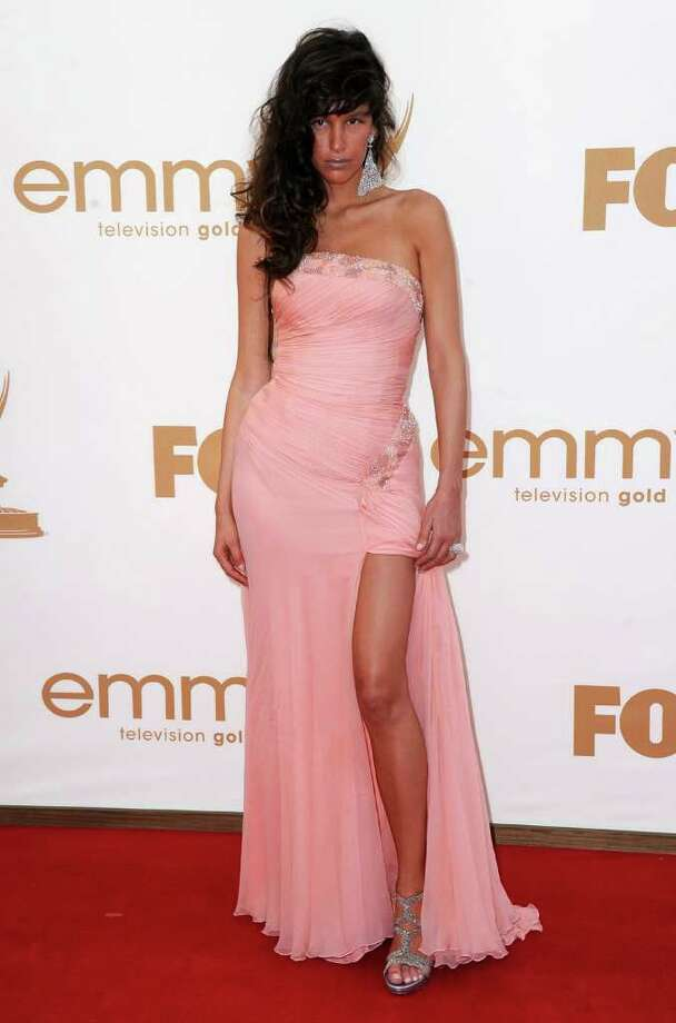 Worst: Paz De La Huerta apparently couldn't decide between a long gown and a minidress. Photo: Frazer Harrison, Getty Images / 2011 Getty Images