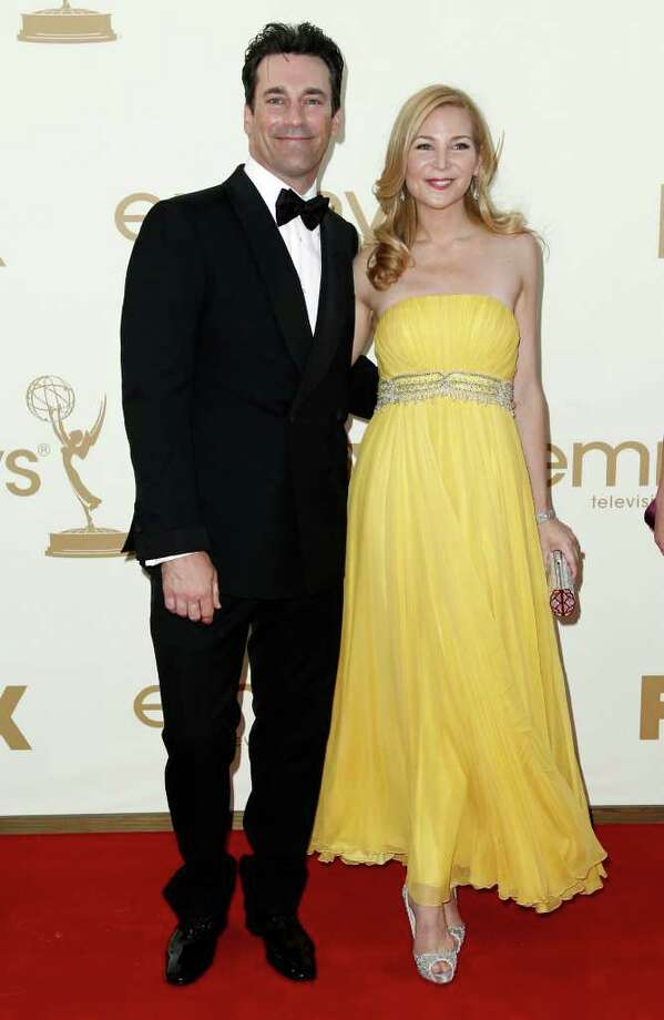 Best: Jon Hamm and Jennifer Westfeldt were the picture of perfection. Westfeldt's sunny gown was a welcome break from all of the striking red dresses on the carpet. Photo: AP