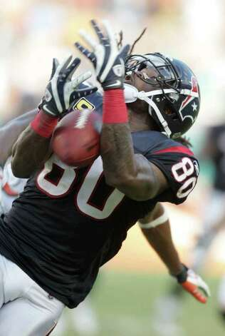 Houston Texans wide receiver Andre Johnson (80) misses drops a ball in the third quarter of a NFL football game against the Miami Dolphins, Sunday, Sept. 18, 2011, in Sun Life Stadium in Miami. The Texans won 23-13. Photo: Nick De La Torre, Houston Chronicle / © 2011 Houston Chronicle