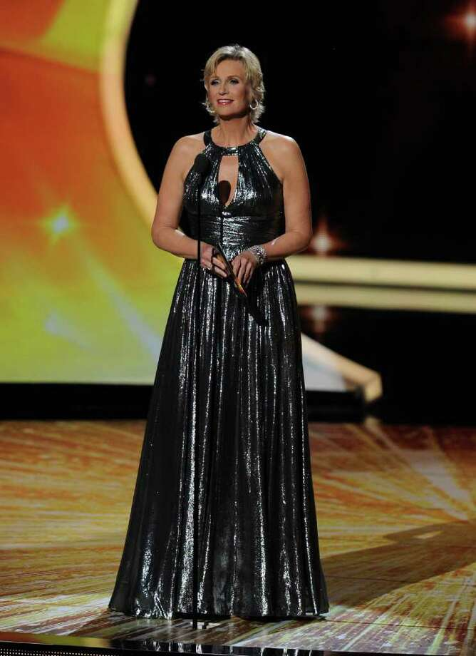LOS ANGELES, CA - SEPTEMBER 18:  Host Jane Lynch speaks onstage during the 63rd Annual Primetime Emmy Awards held at Nokia Theatre L.A. LIVE on September 18, 2011 in Los Angeles, California. Photo: Kevin Winter, Getty Images / 2011 Getty Images