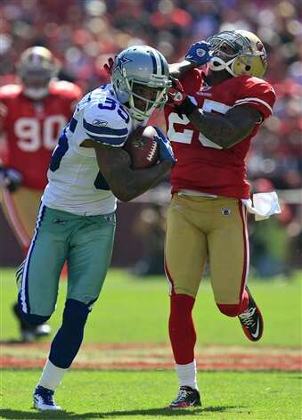 Dallas Cowboys wide receiver Kevin Ogletree (85) stiff arms San Francisco 49ers cornerback Tarell Brown (25) after making a reception in the third quarter of an NFL football game in San Francisco, Sunday, Sept. 18, 2011.  (AP Photo/Marcio Jose Sanchez) Photo: Associated Press