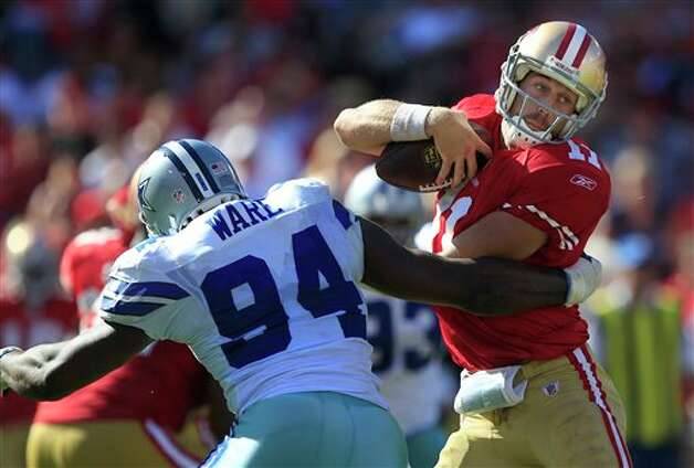 Dallas Cowboys outside linebacker DeMarcus Ware, left, sacks San Francisco 49ers quarterback Alex Smith (11) in the fourth quarter of an NFL football game in San Francisco, Sunday, Sept. 18, 2011. (AP Photo/Marcio Jose Sanchez) Photo: Associated Press